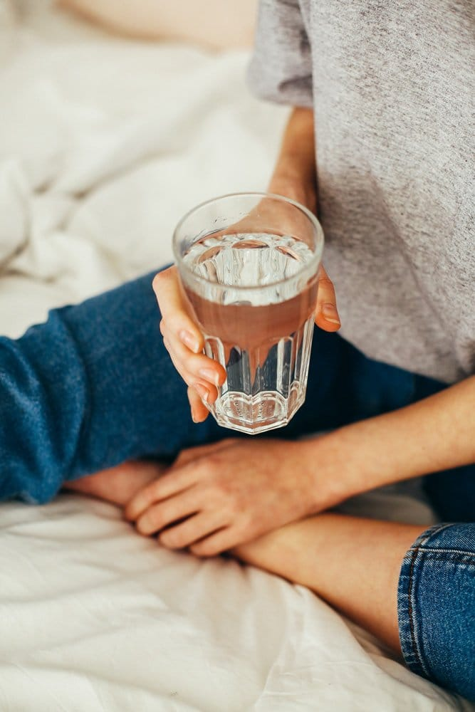 woman drinking water, CBT Therapy for migraines, FL