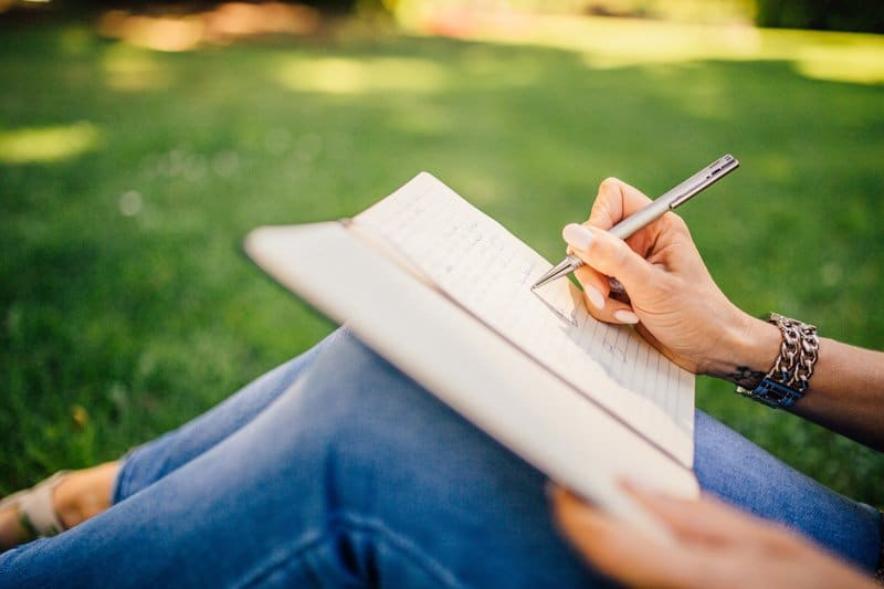 woman journaling, writing for self care, Miami, FL