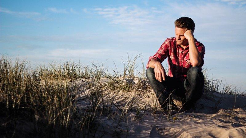 man sad on beach, male self-esteem issues, Ft. Lauderdale, FL