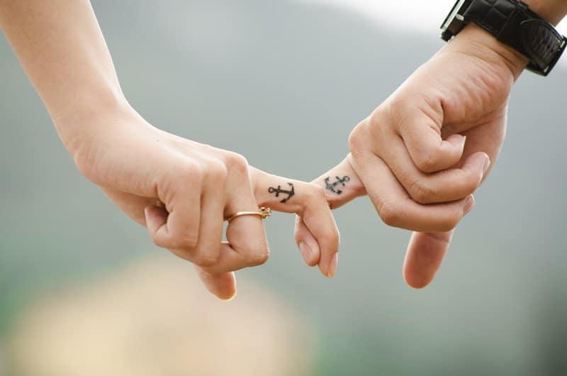 two people holding fingers with anchors tattoos, relationships with values and respect, Ft. Lauderdale, FL