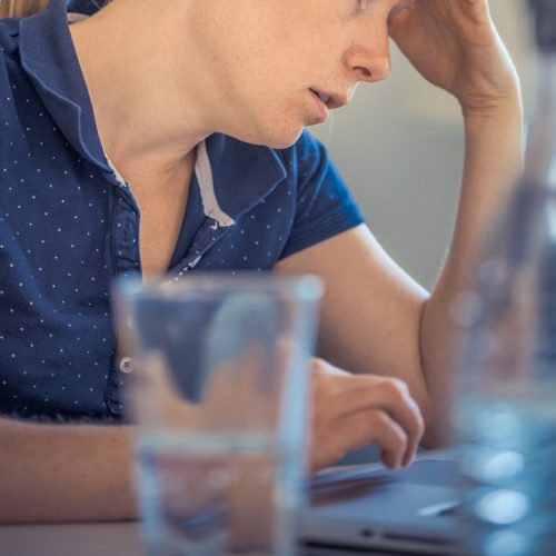 woman researching online, worrying, Anxiety and Migraine Counseling, Ft. Lauderdale, FL