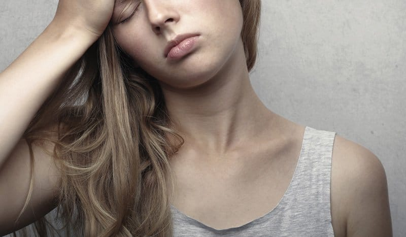 woman in pain, stress and migraine loop, Miami FL migraine therapy