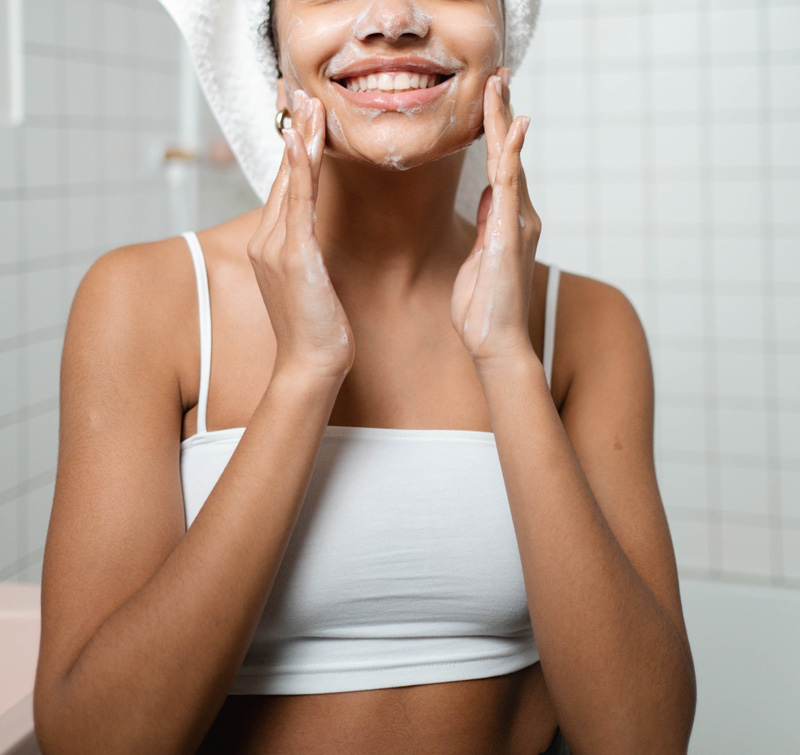 woman washing face in soap, Self-Esteem Therapy